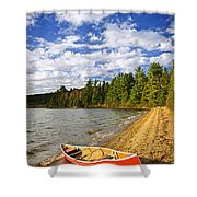Red Canoe On Lake Shore Shower Curtain by Elena Elisseeva
