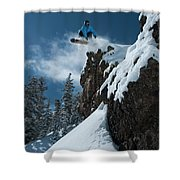 A Male Snowboarder Wearing A Bright Shower Curtain
