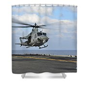 Aviation Boatswains Mate Directs Shower Curtain