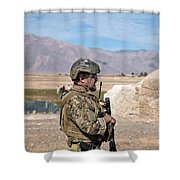 A Coalition Force Member Maintains Shower Curtain