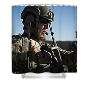 A Coalition Force Member Sets Shower Curtain