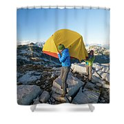 A Couple Of Backpackers Carry Shower Curtain