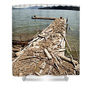 A Dock Covered With Driftwood Shower Curtain