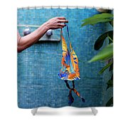 A Female Hand Holding A Bathing Suit Shower Curtain