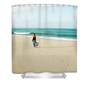 A Girl Walks On The Beach In A Long Shower Curtain