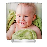 A Happy Baby Lying On Bed In Green Towel Shower Curtain