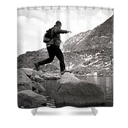 A Man Jumps From One Rock To Another Shower Curtain