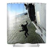 A Naval Air Crewman Jumps From An Shower Curtain