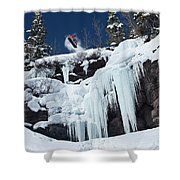 A Snowboarder Jumps Off An Ice Shower Curtain