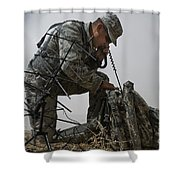 A Soldier Communicates Using A Shower Curtain