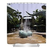 A Water Fountain With Dinosaur Eggs And Dinsosaurs In Universal Studios Shower Curtain