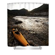 A Whitewater Kayak Rests On The Shore Shower Curtain