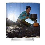 A Woman Making Coffee With Portable Shower Curtain