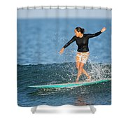 A Woman Rides A Wave On A Longboard Shower Curtain
