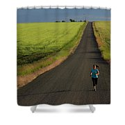 A Woman Running On A Dirt Road Shower Curtain