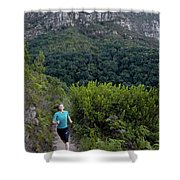 A Woman Running On One Of The Many Shower Curtain