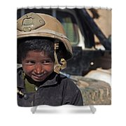 A Young Boy Wears A Coalition Force Shower Curtain