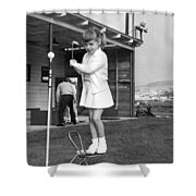 A Young Girl Hits A Golf Ball Shower Curtain