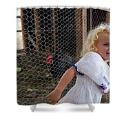 A Young Girl Shows Off Her Familys Shower Curtain