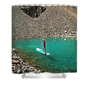 A Young Male Paddleboarding On A Small Shower Curtain