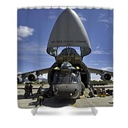 Airmen And Soldiers Load A Ch-47 Shower Curtain