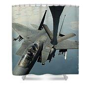 An F-15e Strike Eagle Receives Fuel Shower Curtain