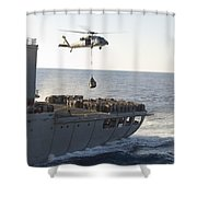 An Mh-60s Sea Hawk Helicopter Carries Shower Curtain