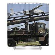 An Rq-2b Pioneer  Uav On An M927 Shower Curtain