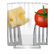 Cheese And Tomato On Forks Against White Shower Curtain
