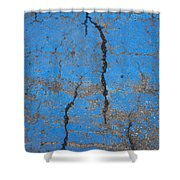 Close Up Of Cracks On A Blue Painted Shower Curtain