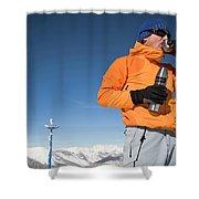 Dressed In Orange, A Skier Sips A Warm Shower Curtain