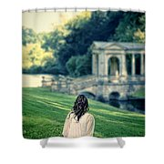 Lady Sitting On A Hill Above A Lake Shower Curtain