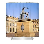 Low Angle View Of Statues In Front Of A Shower Curtain