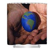 Man Holding Earth Egg Shower Curtain by Jim Corwin