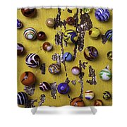 Marbles On Yellow Wooden Table Shower Curtain