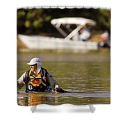 Racer Wading Across A River In An Shower Curtain