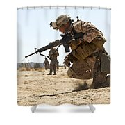Rifleman Kneels To The Ground While Shower Curtain