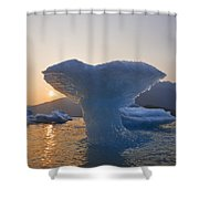 The Sun Sets Beyond An Ice Sculpture Of Shower Curtain