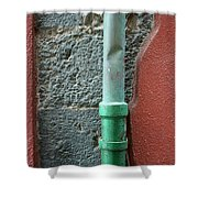 Vertical Drainpipe Against Colorful Shower Curtain