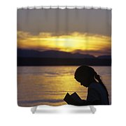 Young Girl Silhouetted Reading A Book On The Beach At Sunset Shower Curtain