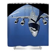 A C-17 Globemaster IIi Receives Fuel Shower Curtain by Stocktrek Images