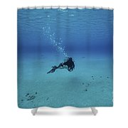 A Diver On A Scooter Explores The Clear Shower Curtain