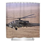 An Ah-64d Apache Longbow Fires A Hydra Shower Curtain