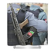 An Ak-47 Rests On The Sling Of An Shower Curtain