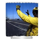 An Aviation Boatswains Mate Directs Shower Curtain