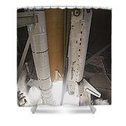 Space Shuttle Discovery Lifts Shower Curtain