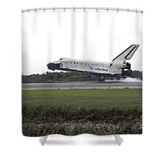 Space Shuttle Discovery Touches Shower Curtain