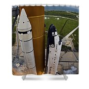 Space Shuttle Endeavour Lifts Shower Curtain