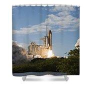 Space Shuttle Atlantis Lifts Shower Curtain