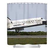 Space Shuttle Discovery Approaches Shower Curtain